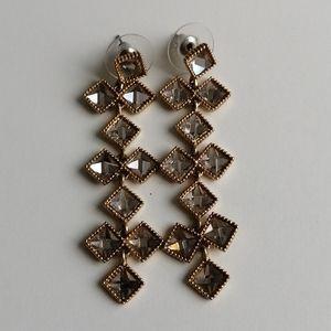Gold tone crystal long earrings